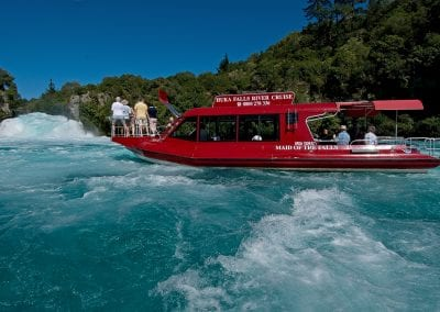 Passengers on Huka Falls River Cruise enjoying the views